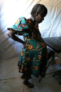 Pregnant woman at UNICEF-supported health center in Sam Ouandja refugee camp, credit: Pierre Holtz for UNICEF